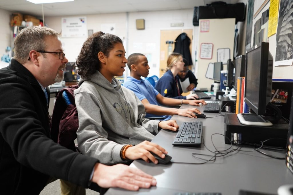 Student receiving instruction in computer Science